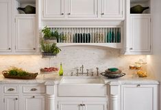 built in plate rack somewhere always looks great in a country kitchen. Could do over a second prep sink. and again the furniture legs built in to give things a custom look. via: Kitchen Cabinets with Furniture-Style Flair - Traditional Home®