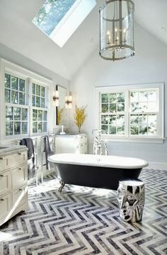 Wow - amazing #chevron floor!  Love all of the windows in this bathroom too <3