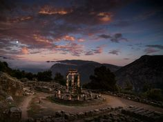 Twilight bathes the sanctuary of Athena Pronaia at Delphi. Pilgrims in ancient Greece may have offered sacrifices here before consulting the oracle of Delphi.
