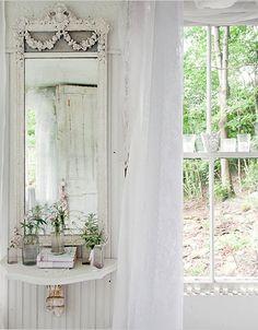 White mirror, gauze curtains
