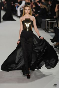 The gold medal detail at the bodice...the drama of it all. By Stephane Rolland Haute Couture 2012