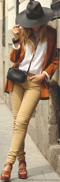 khaki skinnies/white shirt/tan jacket/shoes/hat. Catalina Christiano