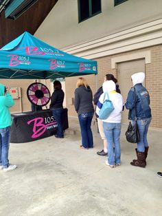 The weather didn't stop people from stopping by to get their Rick Springfield tickets! Buy this Prize Wheel at http://PrizeWheel.com/products/tabletop-prize-wheels/table-clicker-prize-wheel-12-24-slot-adaptab/.