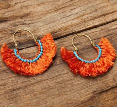 Mango tango funky fluff cotton earrings with silver accents on Etsy, $30.05