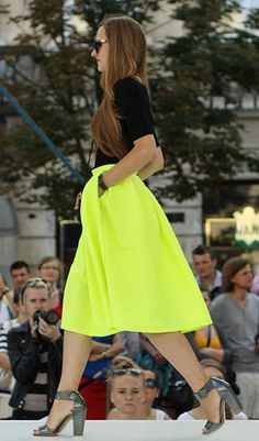 Full, mid length skirt with pockets in a bright color with neutral basics. Love it.