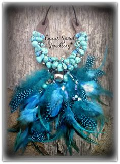 Custom designed beaded horseshoe with genuine Turquoise and feathers.Designed and created by Equus Spirit Jewellery.
