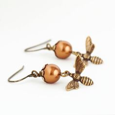 Whether you call them honey bees, bumble bees, or just regular bees these earrings are a wonderful re-imagining of the potent little bug. Bees are associated with industry, ambition, and flight of ima