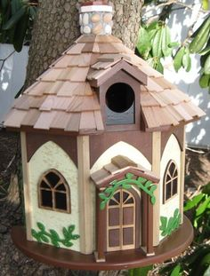 Rustic little cottage bird house.Part of Home Bazaar's Queens Hamlet Collection. Love this!!