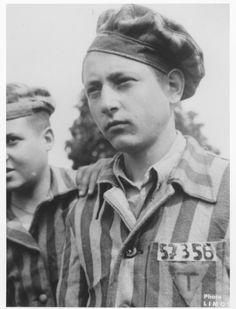 Portrait of a member of the Buchenwald children's transport wearing his camp uniform. The uniform of the boy probably originally belonged to Mozes Kunitz (b. 12/7/26) in Sighet.