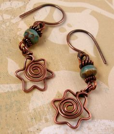 DAVIDKA jewish hebrew judaica star of david copper wire earrings with spiral centers and teal green blue picasso czech glass beads. $30.00, via Etsy.