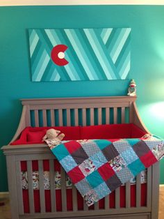 Turquoise Nursery - bold wall color paired with red accents