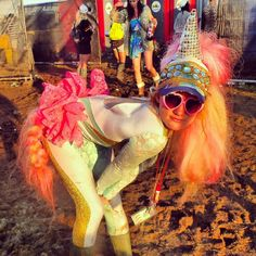 A-girl-dressed-in-a-unicorn-My-Little-Pony-costume-waiting-in-line-to-use-the-portaloos-at-The-Secret-Garden-Party-2012.jpg (590×590)