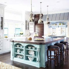 White kitchen with blue island. Love pendants