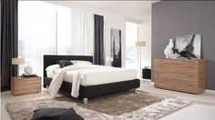 Black and White Bedroom Design Ideas with black leather base bed frame and headboard also white bedding sheets blankets and cushion along varnished wooden bedside table
