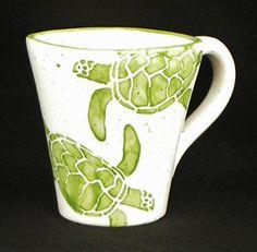 Mugs. Sea Turtle Mugs. Sea. Turtle. Green. Coffee. 14 oz. Handmade by Sara Hunter Designs. $19.00, via Etsy.
