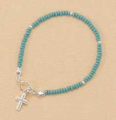 Sterling Silver/2mm Turquoise Glass Bead Child-Size Bracelet, 1/2 inch Cross Charm, 5-1/2 inch Silver Messages. $17.99. Save 18% Off!
