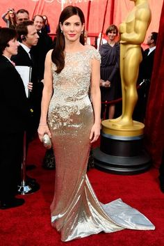 Best Actress winner Sandra Bullock didnt just score a little gold statue, she triumphed on the red carpet, too. Oozing elegance, the star wowed in a floor-skimming metallic Marchesa gown, that was perfectly set off with a hot pink pout and slick, side-swept locks. All-in-all, Sandra won on every count! (2010)