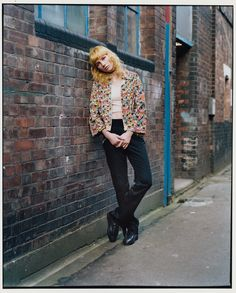 Charlie Barker wears JJacket and trousers The Contemporary Wardrobe Collection. Top Topshop. Choker (worn throughout) model's own.    Photography Claire Shilland