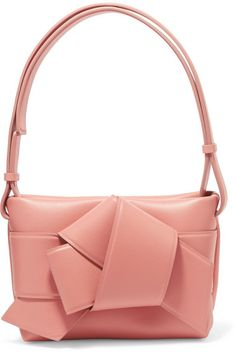 b40d5e152dbfaa Blush leather (Calf) Magnetic fastening at open top Comes with dust bag  Weighs approximately