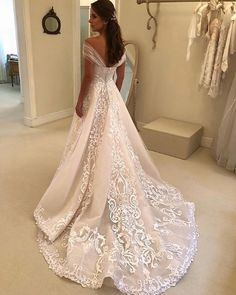 This lace and embroidery bridal gown can be recreated with any design preferences. Our version will have the same overall look but will cost much less than a couture original. Email us your favorite ideas for pricing! Disney Wedding Dresses, Western Wedding Dresses, Stunning Wedding Dresses, Affordable Wedding Dresses, Custom Wedding Dress, Luxury Wedding Dress, Designer Wedding Dresses, Beautiful Gowns, Bridal Dresses