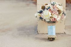 Today's Bouquet Bar is a romantic creation by Blush Botanicals. Composed of peonies, cymbidium orchids, dusty miller, and roses and finished off with a satin ribbon and gold chain accents.