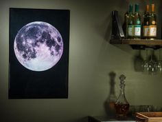 Metallic paper is the secret to the glow and three-dimensional appearance of this moon print that hangs in the entertainment room of DIY Network's Blog Cabin 2015.