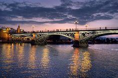 The Triana bridge at night in Sevilla