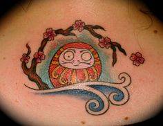 Japanese cartoon character with cherry branch on female upper back