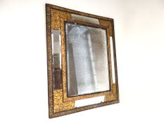 Beautiful mirror #LouisXIV with #mirroded #panels in embossed #copper, blackened #wood and beveled mercury glass, decorated with flowers and foliage. 19th century. For sale on Proantic by Luc de Laval Antiquités.
