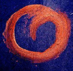 black lava hisses/in the surf/exposing its ruby heart  (haiku and enso by susan)