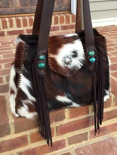 The Bonnie Bag. This customer chose turquoise stones, hand cut suede fringe, and exterior suede lined side pockets. gowestdesigns.us