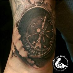 Black and gray realism compass tattoo