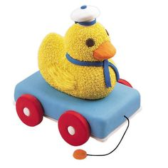 Duck Wagon Cake - Kids and adults will flock around this whimsical transport and its freeloading rider. The more the merrier. This Sheet Pan cake wagon and 3-D Rubber Ducky Pan cake provides 40 tasty servings.