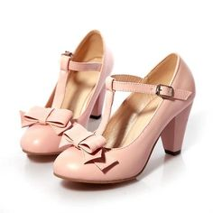 """New. Tall almond toe mary janes with bows. T-strap buckle. 3"""" heel. Vegan leather. Available in US women's sizes 6, 6.5, 7, 7.5, 8, 8.5, 9, and 9.5. Item is sent direct from factory; may need to be aired-out; <b>please wait 3-5 weeks to arrive.</b>"""