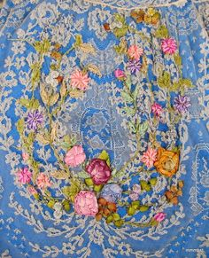Closeup of ribbonwork on lace dressing gown