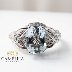 This aquamarine engagement ring is crafted in solid 14k white gold with a 1.8ct oval shaped natural aquamarine set into a gorgeous floral basket setting on top of a diamond pebble band. The timeless and classic design of this leaf ring will make your engagement unforgettable.