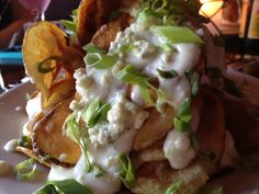 blue cheese app with skillet chips, made in-house, smothered with melted blue cheese & scallions
