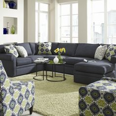 Sectional Sofas Sectional in the charcoal gray Don ut like all the matchup fabric on the
