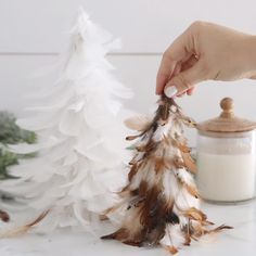 Make beautiful and whimsical Feather Trees for Christmas decor around the house for a fraction of the cost of buying them! Silver Christmas Decorations, Easy Christmas Crafts, Diy Christmas Ornaments, Homemade Christmas, Christmas Projects, Simple Christmas, Deco Table Noel, Cone Christmas Trees, Farmhouse Christmas Decor