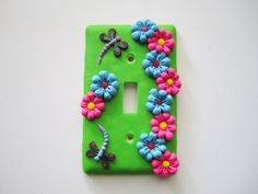 Polymer clay light switch plate by DawnsClayFantasy on Etsy, $12.50