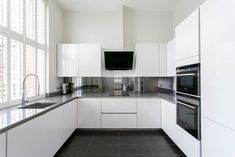 Luxury ground floor two bedroom apartment.  Designer high gloss kitchen with quartz surfaces and underfloor heating. within the gated development of Repton Park, benefiting CCTV and on site Virgin Active, spa gym and bistro. Fully furnished. Two allocated parking spaces. #reptonpark #propertyhunt #dreamproperty #luxuryapartment #quartzsurface #whitekitchen #kitcheninspiration