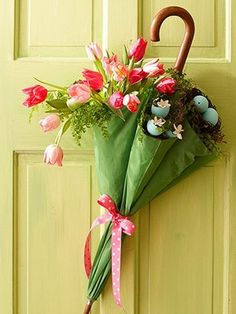 Here's a cute Do-It-Yourself idea for Spring! Take a pastel colored umbrella, tie it in the middle to ensure that materials don't fall down and fill it with some silk florals and decorative accents. (Those you can probably get at your local Michael's, A.I. Friedman or craft store). Then, hang it on your front door in time for Spring for your guests to enjoy!