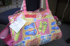 """We do a monthly open sew """"Sew Obsessed"""" where we provide a project or people bring their own to work on. Look at this cute beach tote we are making this April."""