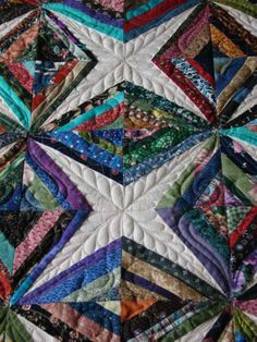 This is a scrap quilt called Diamonds Are Forever. It was made by 'Prairie Quilter; from 'The Quilting Board' Quilted by Charisma. Love love love this quilt!