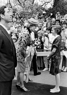 1986-04-30 Diana receives a bouquet from a child at the British Columbia Legislature Building