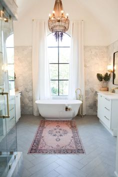 MASTER BATH Freestanding tub as focal in front of window with drapes Turkish rug Love the Tile work patterns on floor and wall