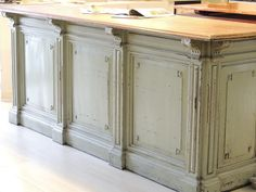 Kitchen island made from vintage grocery counter.  LOVE