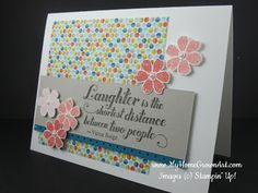 """Stamps:   Bloomin' Marvelous   Feel Goods Paper:   Whisper White card stock 5 1/2"""" x 8 1/2""""   Sahara Sand card stock  1 1/2"""" x 4 3/4""""   Island Indigo card stock  1""""x 4 3/4""""   Sycamore Street DSP  3 3/4"""" x 3 3/4""""   Ink:Tangerine Tango, Early Espresso (126974)   Tools and Accessories:   Dotted Scallop Ribbon Border Punch   Pearl Basic Jewels  Stampin' Dimensionals"""