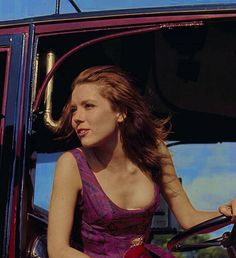 Diana Rigg as 'Emma Peel' in a vintage car on the set of the television series 'The Avengers' in 1967.