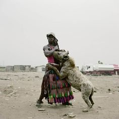 Hyena Handlers of Nigeria: a) hyenas are HUGE, b) these men are so stylin'